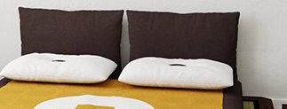 Testata letto con cuscini